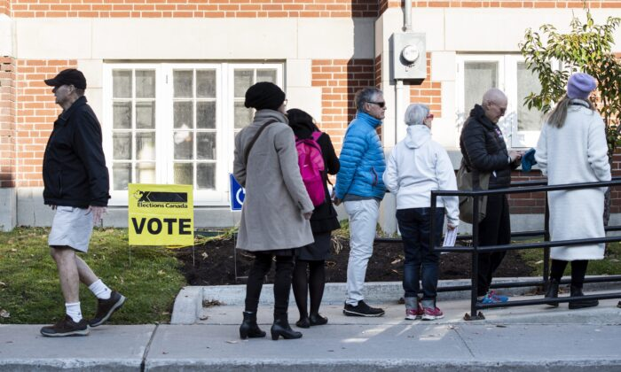 People line up outside a polling station in Ottawa during the last federal election on Oct. 21, 2019. (The Canadian Press/Justin Tang)