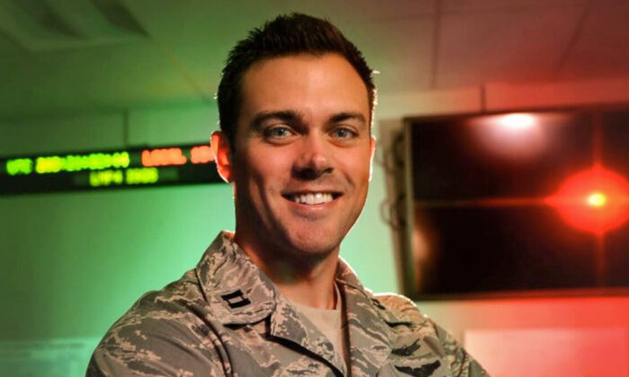 Capt. Matthew Lohmeier, 460th Operations Group Block 10 chief of training, stands in the Standardized Space Trainer on Buckley Air Force Base, Colo., on July 22, 2015. (Darren Scott/U.S. Air Force)