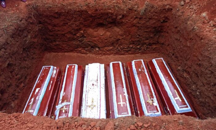 Coffins of six Irigwe Christian victims of sectarian violence interred in Jebbu-Miango, on Aug. 14, 2021. (Lawrence Zongo/The Epoch Times)