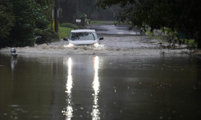 A car attempts to drive through flood waters near Peachtree Creek near Atlanta, Ga., on Aug. 17, 2021. (Brynn Anderson/AP Photo)