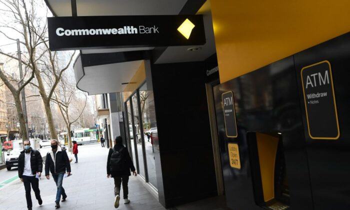 People walk past a branch of the Commonwealth Bank of Australia (CBA) branch in Melbourne, Australia, on Aug. 11, 2021. (William West/AFP via Getty Images)