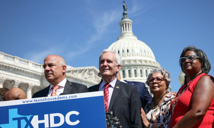 Texas State Democrats (L-R) Democratic Chair Rep. Chris Turner (TX-101), Rep. Rafael Anchia (TX-103), Rep. Senfronia Thompson (TX-141), and Rep. Rhetta Bowers (TX-113) at a news conference outside the U.S. Capitol on July 13, 2021. More than 60 Texas House Democrats left the state to Washington, DC, to block a voting restrictions bill by denying a Republican quorum. (Kevin Dietsch/Getty Images)