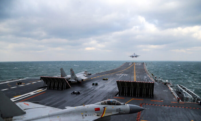 Chinese J-15 fighter jets are launching from the deck of the Liaoning aircraft carrier during military drills in the Yellow Sea, off China's east coast on Dec. 23, 2016. (STR/AFP via Getty Images)