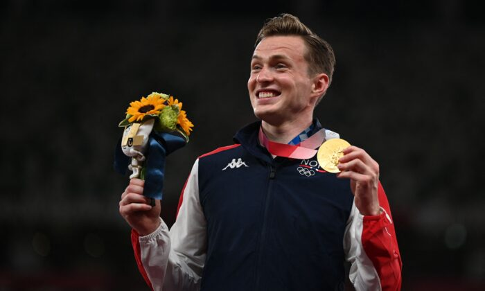 Norway's Karsten Warholm, Gold medallist,   poses on the podium after the men's 400m hurdles event during the Tokyo 2020 Olympic Games at the Olympic Stadium in Tokyo on Aug. 3, 2021. (Charly Triballeau/AFP via Getty Images)