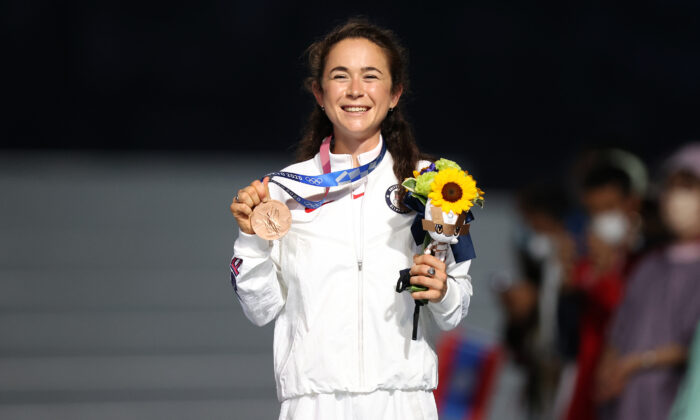 Bronze medalist Molly Seidel of Team United States pose during the medal ceremony for the Women's Marathon Final during the Closing Ceremony of the Tokyo 2020 Olympic Games at Olympic Stadium in Tokyo, Japan, on Aug. 8, 2021. (Naomi Baker/Getty Images)