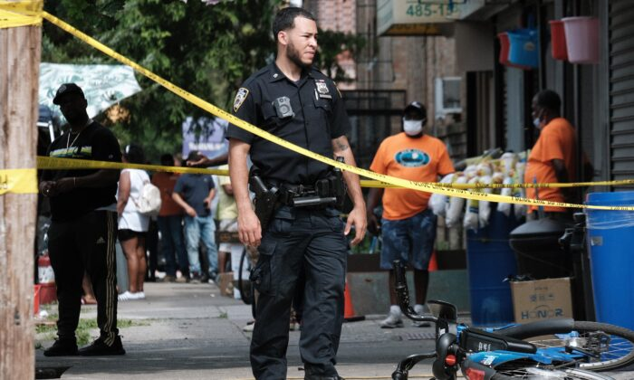 Police on the scene of a shooting in Brooklyn in New York City on July 14, 2021. (Spencer Platt/Getty Images)