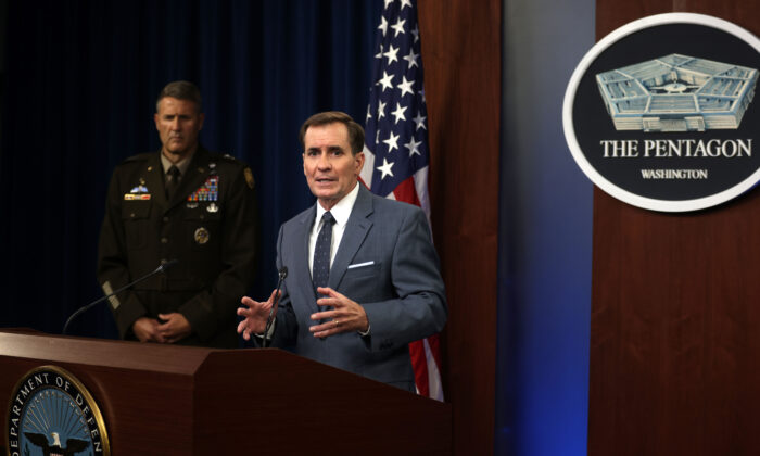 Department of Defense Press Secretary John Kirby (R) speaks as Army Major General William Taylor (L) listens during a news briefing at the Pentagon in Arlington, Va., on August 17, 2021. (Alex Wong/Getty Images)