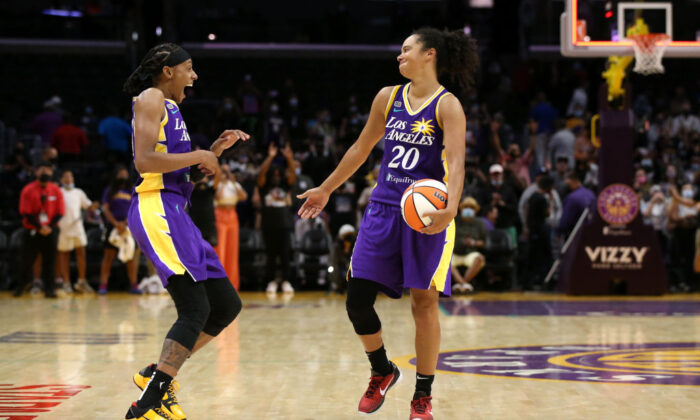 Brittney Sykes #15 and Kristi Toliver #20 of the Los Angeles Sparks celebrate after their 85-80 win in overtime against the Atlanta Dream at Staples Center Los Angeles on Aug. 17, 2021. (Katharine Lotze/Getty Images)
