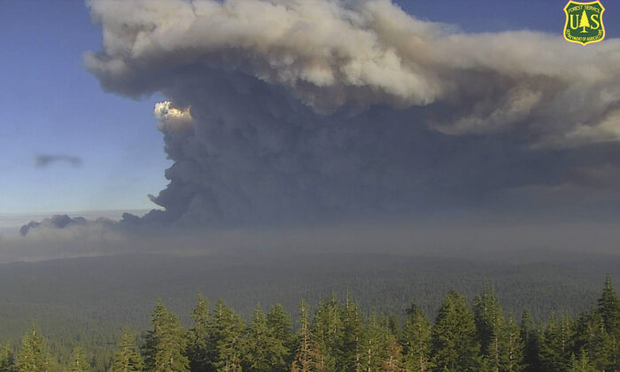 In this image from a U.S. Forest Service wildfire monitoring camera, plumes of smoke rise from the Caldor Fire in El Dorado County, Calif., on Aug. 17, 2021. (U.S. Forest Service/ALERTWildfire Network via AP)
