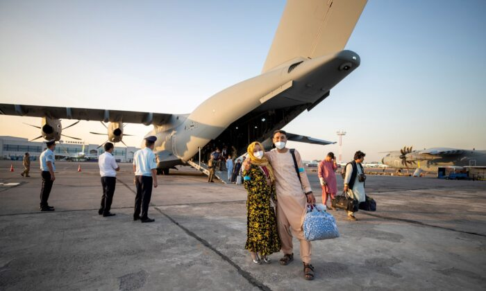 Evacuees from Afghanistan as they arrive in an Airbus A400 transport aircraft of the German Air Force Luftwaffe in Tashkent, Uzbekistan, on Aug. 17, 2021. (Marc Tessensohn/Twitter @Bw_Einsatz/Handout via Reuters)