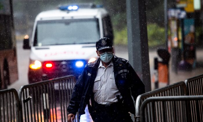Police stand guard in Hong Kong on July 30, 2021. (Isaac Lawrence/AFP via Getty Images)