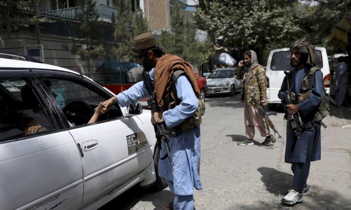 Taliban extremists man a checkpoint in Kabul, Afghanistan, on Aug. 18, 2021. (Rahmat Gul/AP Photo)