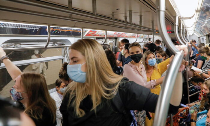 People wear masks while riding on the subway in New York City on Aug. 2, 2021. (Andrew Kelly/Reuters)
