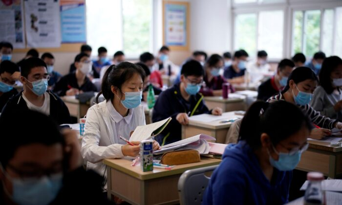 Students are seen inside a classroom at a high school in Shanghai, China, on May 7, 2020. (Aly Song/Reuters)