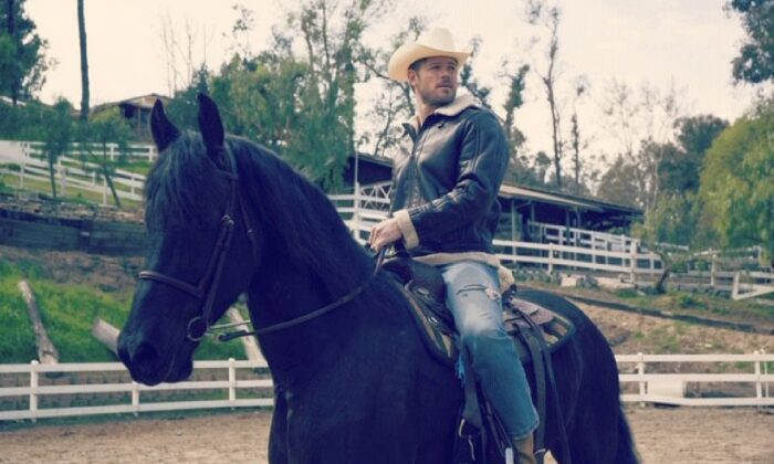 """Hollywood actor Trevor Donovan, who has a pivotal role in the new """"Reagan"""" movie, at a friend's ranch in California's Simi Valley helping to break in a new horse. (Trevor Donovan)"""