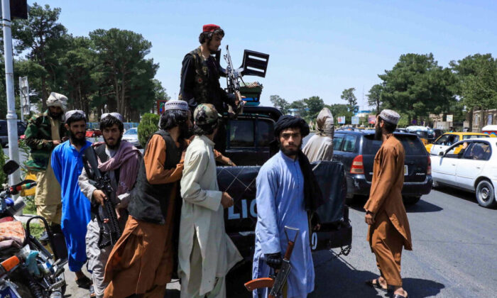 Taliban forces patrol a street in Herat, Afghanistan, on Aug. 14, 2021. (Stringer/Reuters)