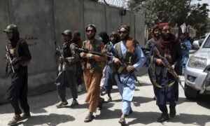 Taliban Violently Break Up Protest in Afghanistan as Thousands Try to Flee Kabul