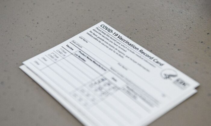 A COVID-19 vaccine record card is seen at a vaccination site in Miami Gardens, Fla., on April 14, 2021. (Chandan Khanna/AFP via Getty Images)