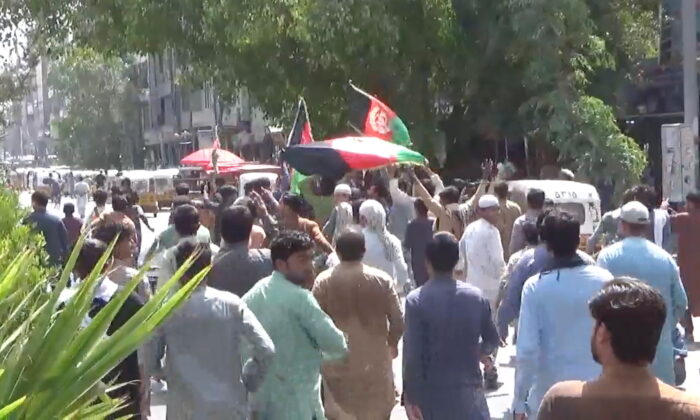 People carry Afghan flags as they take part in an anti-Taliban protest in Jalalabad, Afghanistan, on Aug. 18, 2021 in this screen grab taken from a video. (Pajhwok Afghan News/Handout via Reuters)