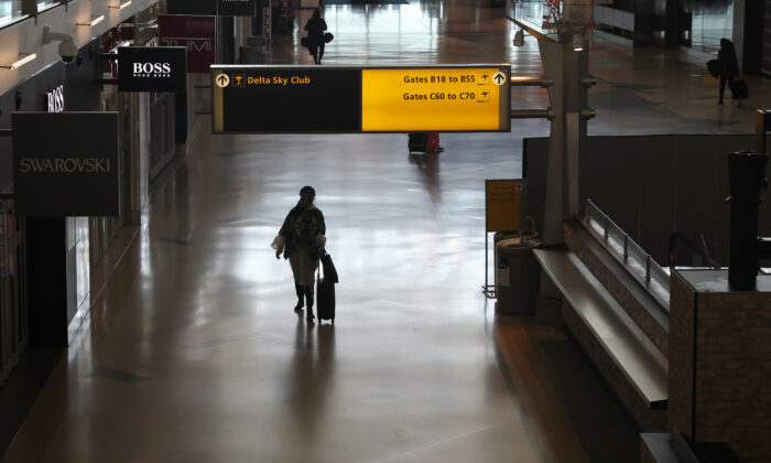 Air travelers walk through a terminal as the COVID-19 outbreak continues, at New York's JFK International Airport in New York, May 15, 2020. (Shannon Stapleton/Reuters)