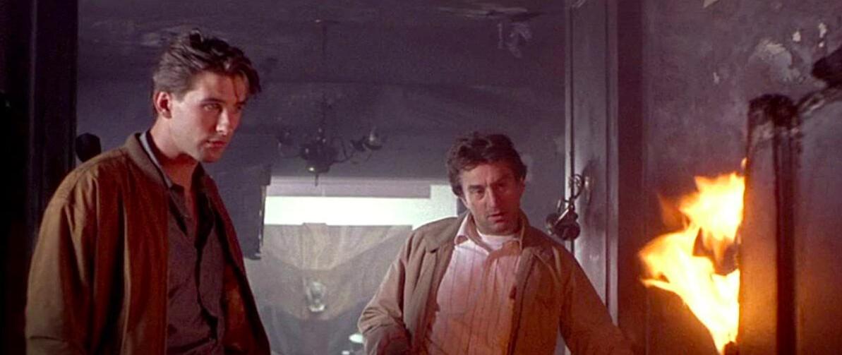 two men watch a fire in BACKDRAFT