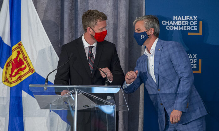 Nova Scotia Liberal Leader Iain Rankin (L) and Progressive Conservative Leader Tim Houston bump elbows at a Halifax Chamber of Commerce pre-election event in Halifax on Aug. 4, 2021. (The Canadian Press/Andrew Vaughan)