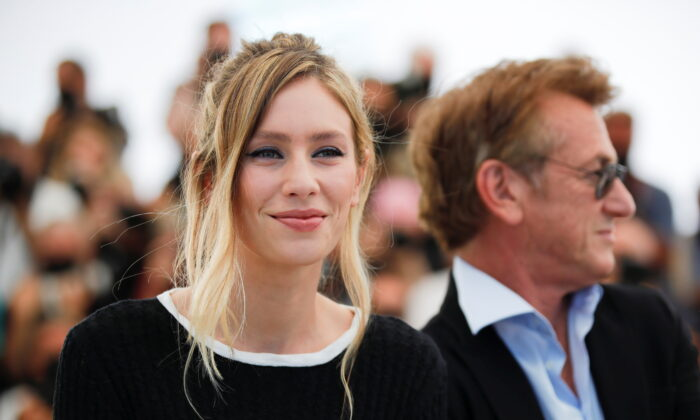 """The 74th Cannes Film Festival. Photocall for the film """"Flag Day"""" in competition. Director Sean Penn and cast member Dylan Penn pose in Cannes, France, on July 11, 2021. (Sarah Meyssonnier/Reuters)"""