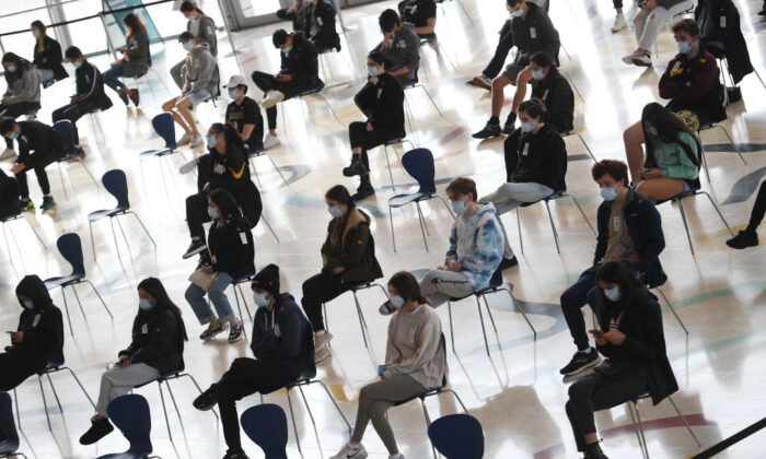 Students wait to receive the Pfizer vaccine for Covid-19 at Qudos Arena, in Sydney, Australia, on Aug. 9, 2021(Dean Lewins-Pool/Getty Images)