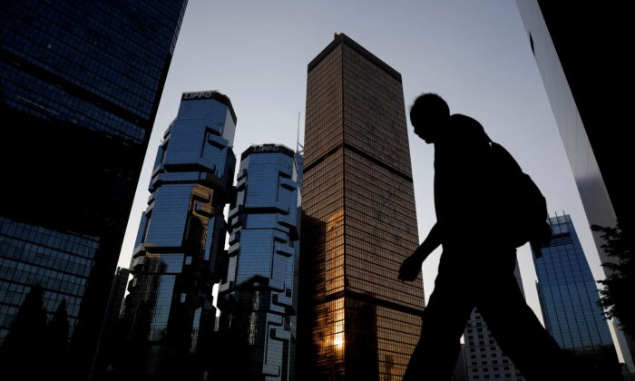 A man walks past buildings at a business district in Hong Kong, on Nov. 4, 2019. (Kim Kyung-Hoon/Reuters)