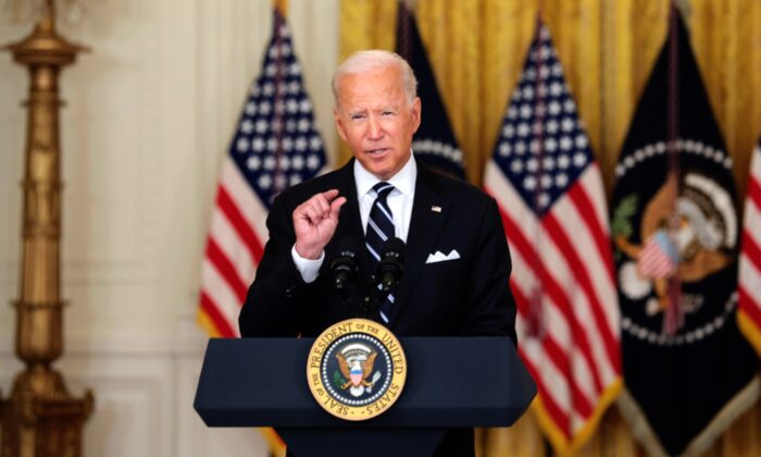 President Joe Biden gestures as he delivers remarks on the COVID-19 response and the vaccination program in the East Room of the White House on Aug. 18, 2021 in Washington, DC. (Anna Moneymaker/Getty Images)