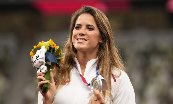 Silver medalist Maria Andrejczyk, of Poland, poses on the podium during the medal ceremony for the women's javelin throw at the 2020 Summer Olympics, in Tokyo, on Aug. 7, 2021. (Martin Meissner/AP Photo)
