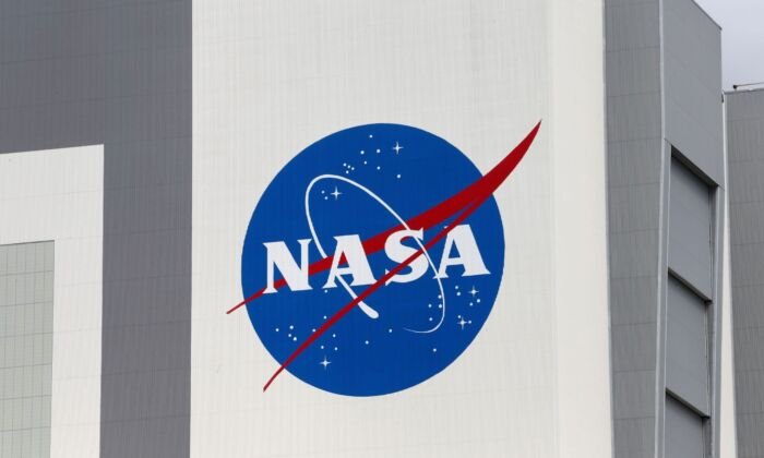 The NASA logo is seen at Kennedy Space Center ahead of the NASA/SpaceX launch of a commercial crew mission to the International Space Station in Cape Canaveral, Florida, U.S., on April 16, 2021. (Joe Skipper/NASA)