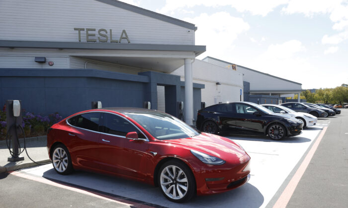 Tesla cars charge at a Tesla Supercharger station in Corte Madera, Calif., on April 26, 2021. (Justin Sullivan/Getty Images)