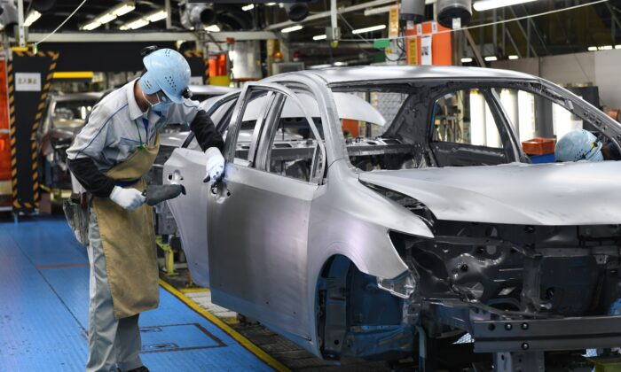 Workers assembling fourth generation Toyota Prius cars on the production line at the company's Tsutsumi assembly plant in Toyota City, Aichi prefecture, on Dec. 8, 2017. (Toshifumi Kitamura/AFP via Getty Images)