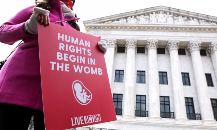 A pro-life activist holds a sign outside the U.S. Supreme Court during the 48th annual March for Life in Washington on Jan. 29, 2021. (Alex Wong/Getty Images)
