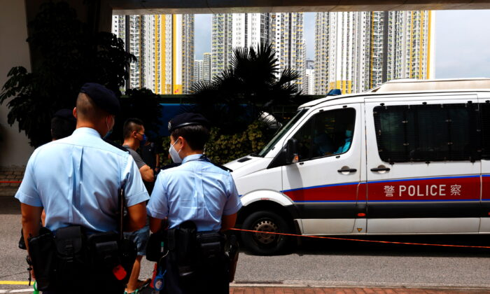 A police van carries a member of Hong Kong University Student Union to West Kowloon Magistrates' Courts building over national security law in Hong Kong, on Aug. 19, 2021. (Tyrone Siu/Reuters)