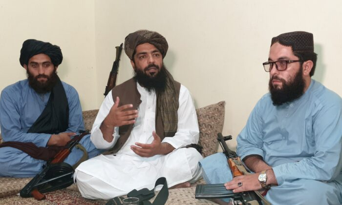 Waheedullah Hashimi (C), a senior Taliban commander, gestures as he speaks with Reuters during an interview at an undisclosed location near the Afghanistan–Pakistan border on Aug. 17, 2021. (Stringer/Reuters)