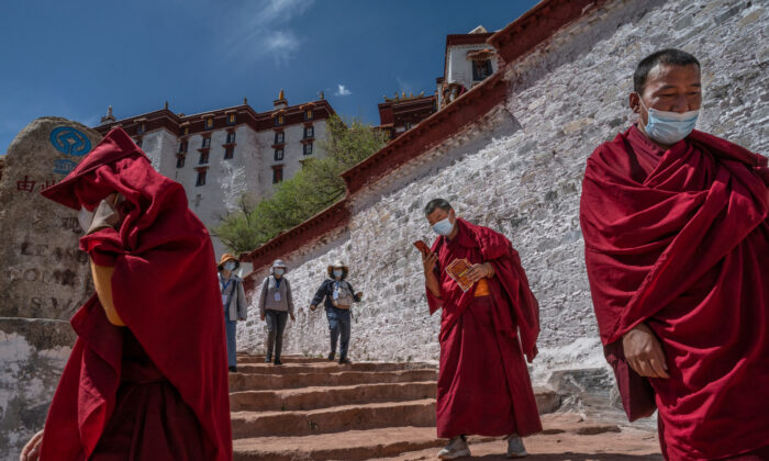 Tourists visit the Potala Palace, a UNESCO heritage site, during a government organized visit for journalists in Lhasa, Tibet, China, on June 1, 2021. (Kevin Frayer/Getty Images)