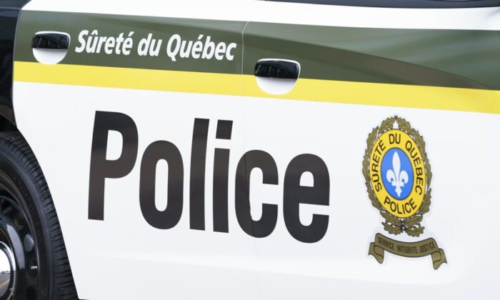 A Sûreté du Québec police car is seen in Montreal on  July 22, 2020. The police officer who was shot and wounded during a traffic stop earlier this week is thanking the public for their support. ( The Canadian Press/Paul Chiasson)