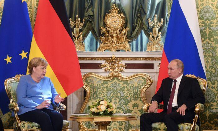 German Chancellor Angela Merkel and Russian President Vladimir Putin talk during their meeting in the Kremlin in Moscow, Russia, on Aug. 20, 2021. (Evgeny Odinokov, Sputnik, Kremlin/Pool Photo via AP)