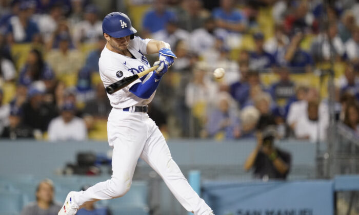 Los Angeles Dodgers' Trea Turner singles during the third inning of a baseball game against the New York Mets in Los Angeles on Aug. 19, 2021. (AP Photo/Ashley Landis)