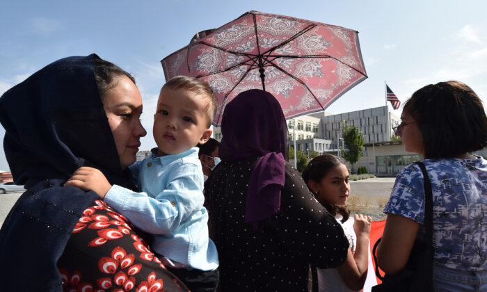 Afghan refugees, who fled Afghanistan in 1996, attend a rally in front of the U.S. Embassy in Bishkek, on Aug. 19, 2021. (Vyacheslav Oseledko/AFP)
