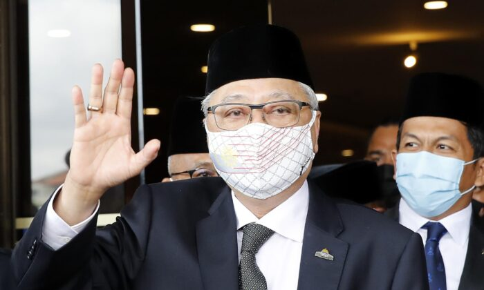 Former Deputy Prime Minister Ismail Sabri Yaakob waves to media as he leave after meeting with the King at national palace in Kuala Lumpur, Malaysia on Aug. 19, 2021. (FL Wong/AP Photo)