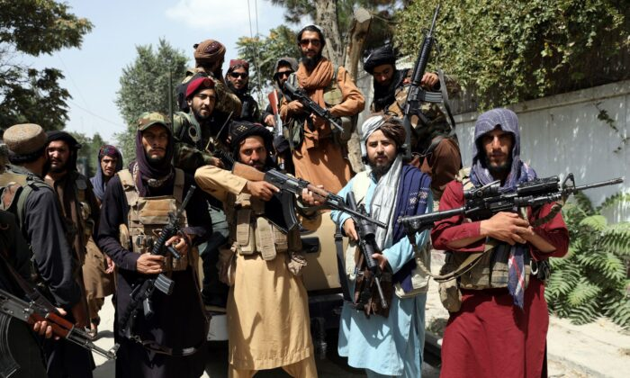 Taliban fighters pose for a photograph in Kabul, Afghanistan, on Aug. 19, 2021. (Rahmat Gul/AP Photo)