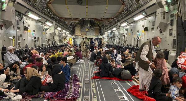 Afghan people sit inside a U S military aircraft
