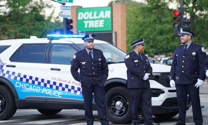 Chicago police officers stand on an intersection in southwest Chicago on Aug. 19, 2021. (Cara Ding/The Epoch Times)