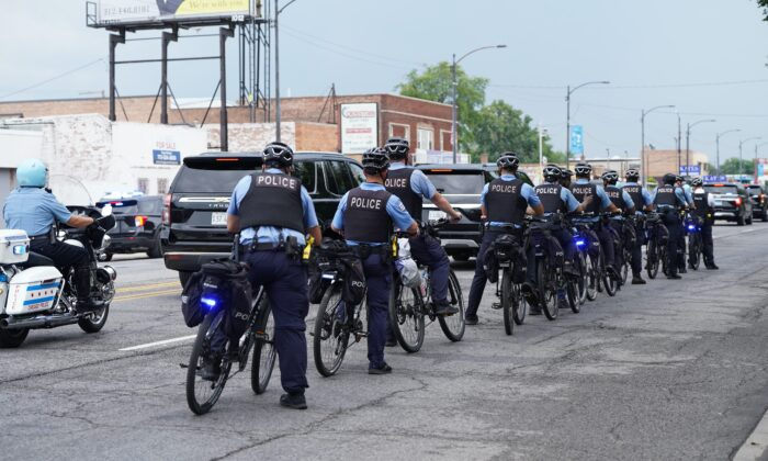 Chicago police officers ride in southwest Chicago on Aug. 19, 2021. (Cara Ding/The Epoch Times)