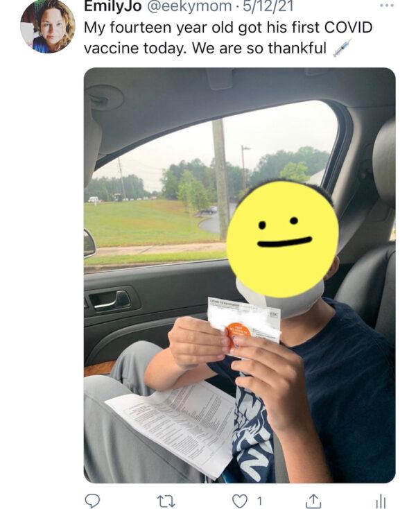 Aidan showing vaccine card