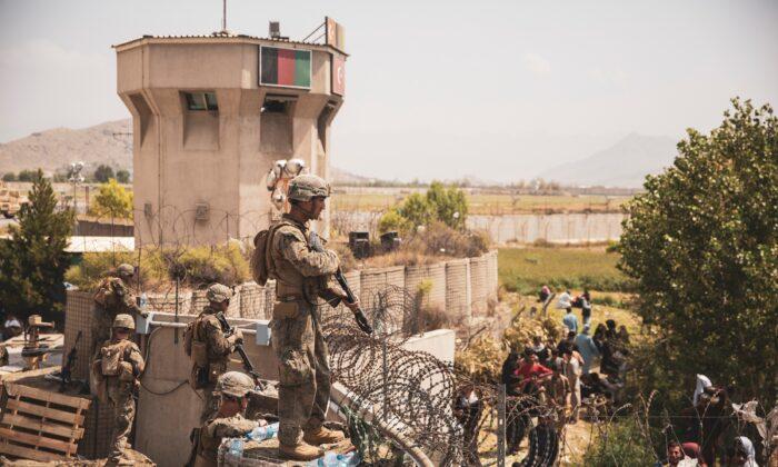 U.S. Marines stand guard at an Evacuee Control Checkpoint at Hamid Karzai International Airport, Kabul, Afghanistan, on Aug. 20, 2021. (Sgt. Victor Mancilla/U.S. Marine Corps/Handout via Reuters)