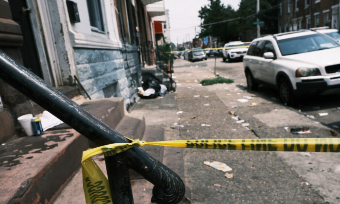 Police tape blocks a street where a person was recently shot in a drug related event in Philadelphia, Pa., on July 19, 2021. (Spencer Platt/Getty Images)